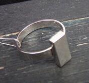 Ring med silvertacka